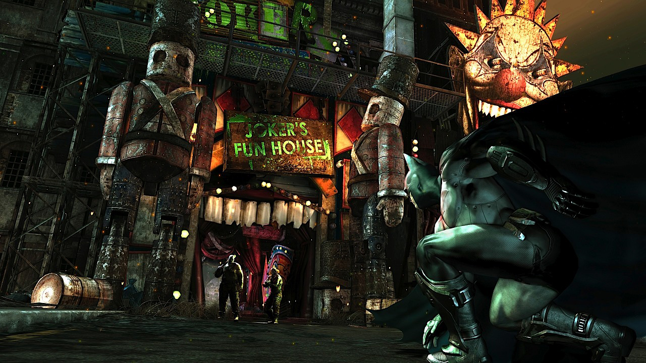 Batman is about to enter the domain of the Joker. The open mouth decor at the door symbolizes, that we are entering the head of the Joker, while inside many many environment objects and scenes are symbolic of the Joker'S twisted psyche.